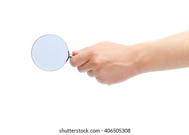 The hand of the man holds a magnifying glass. A magnifying glass in a hand on a white background.