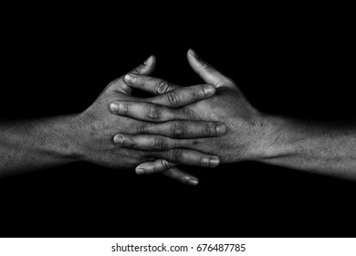 hand of man join together on black in white tone, adherence concept