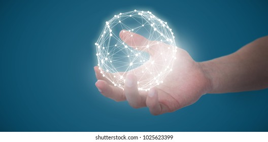 Hand of man pretending to hold an invisible object against blue