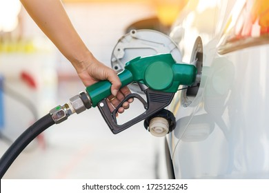 Hand Man Refill and filling Oil Gas Fuel at station. Gas station - refueling.To fill the machine with fuel. Car fill with gasoline at a gas station. Gas station pump.