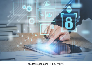 Hand of man in suit using tablet computer in office with double exposure of online security interface and social media icons. Concept of data protection. Toned image