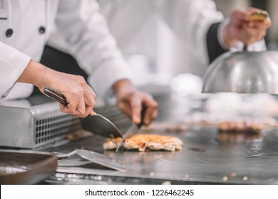 Hand of man take cooking of meat with vegetable grill, Chef cooking wagyu beef in Japanese teppanyaki restaurant