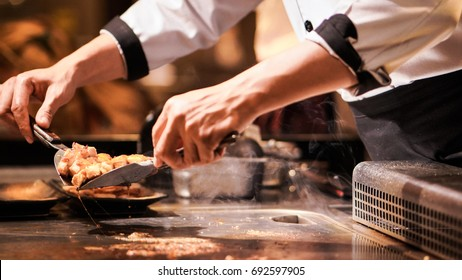 Hand of man take cooking of meat with vegetable grill,Chef cooking wagyu beef in Japanese teppanyaki restaurant