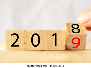 hand man try to open or flip to find the trend new year 2019, happy new year concept