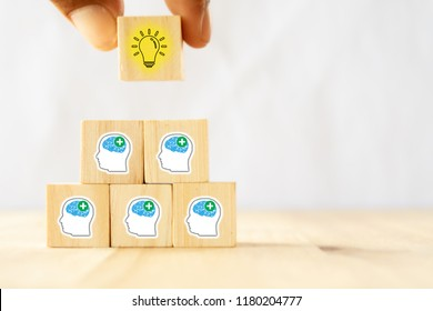 hand man try to pull or put an idea after the positive thinking team are brainstorm, meeting, discuss, find a solution, resolve the problem