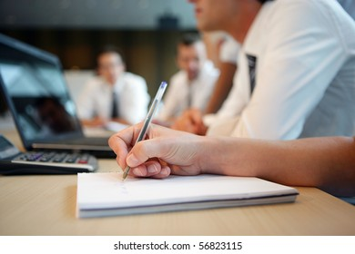 Hand of a man writing on a document
