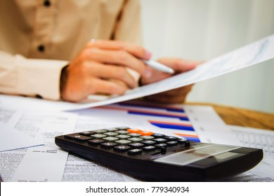 Hand man Writing tax on desk about at
