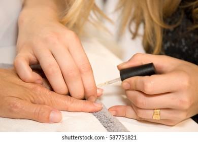 hand manicure at beauty salon