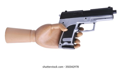Hand mannequin with a toy gun.The isolated image on a white background