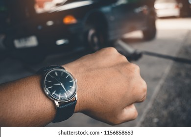 Hand of man's Wrist Watch Waiting for the car repair ,Llong time concept.