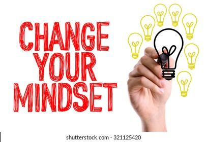 Hand with marker writing: Change Your Mindset
