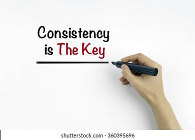 Hand with marker writing: Consistency is The Key