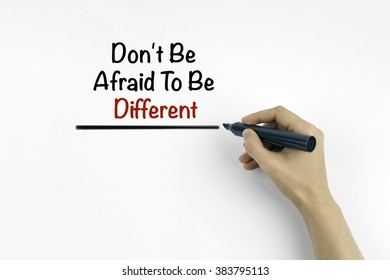 Hand with marker writing - Don't Be Afraid To Be Different