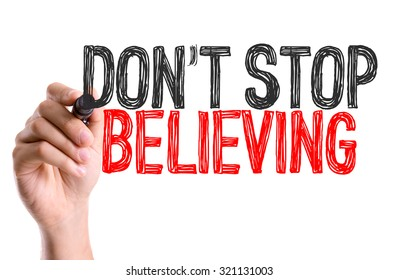 Hand with marker writing: Don't Stop Believing