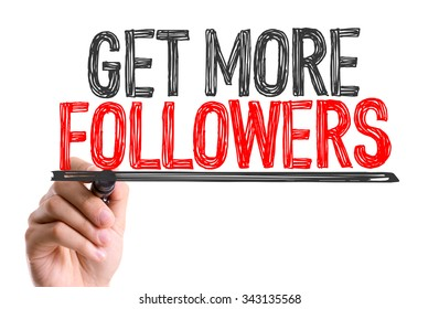 Hand with marker writing: Get More Followers