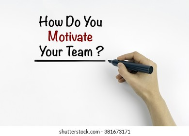 Hand with marker writing: How Do You Motivate Your Team ?