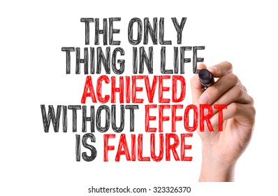Hand with marker writing: The Only Thing In Life Achieved Without Effort Is Failure