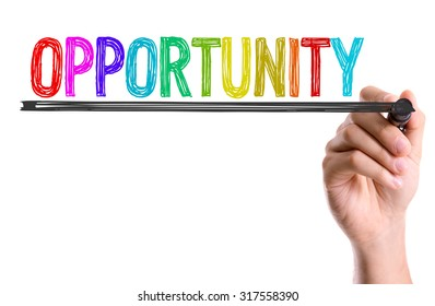 Hand with marker writing: Opportunity
