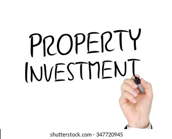 A hand with a marker writing 'Property Investment'.