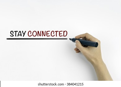 Hand with marker writing: Stay Connected