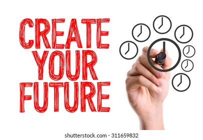 Hand with marker writing the word Create Your Future