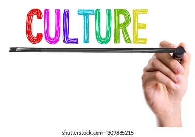 Hand with marker writing the word Culture