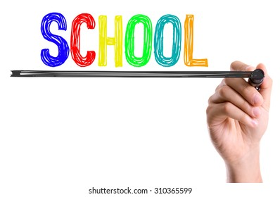Hand with marker writing the word School