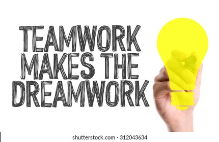 Hand with marker writing the word Teamwork Makes the Dreamwork