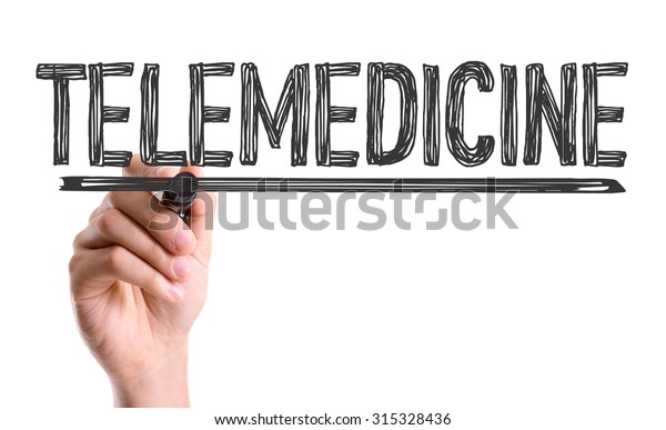 Hand with marker writing the word Telemedicine
