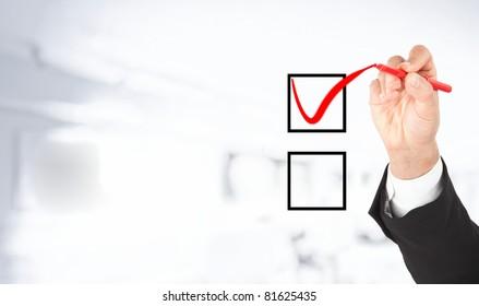 Hand marking one option. White background.