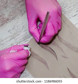 hand master with tool for microblading, training in permanent makeup