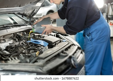 Hand mechanic in repairing car,Change the Oil.Car maintenance, concept. Middle shoot