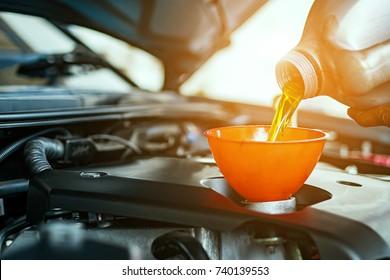 Hand mechanic in repairing car,Change the Oil
