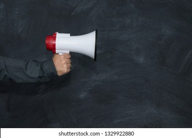 hand with megaphone and school