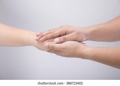 Hand of men reassuring her female