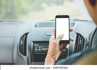 The hand of men are using smartphones in cars, mockup phone, travel ideas and technology.