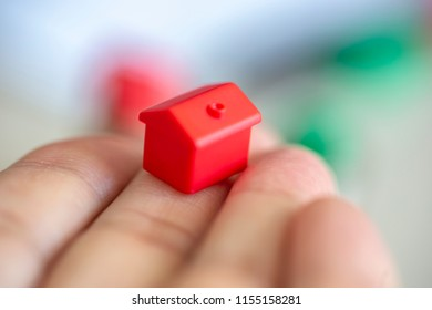 Hand with miniature house
