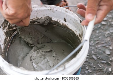 Hand mixing cement or concrete by trowel for construction or repair work