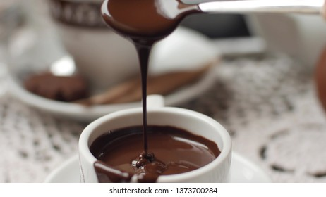 hand mixing chocolate in a hot milk, preparing hot chocolate or cacao, bautiful soft focus shot