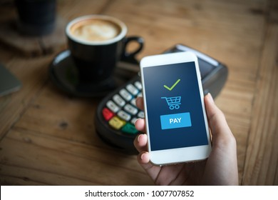 Hand and mobile payment in coffee shop ,online shopping concept