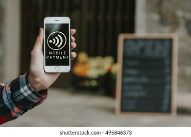 hand with mobile phone and online payment
