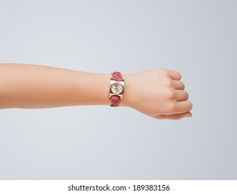 Hand with modern watch showing precise time