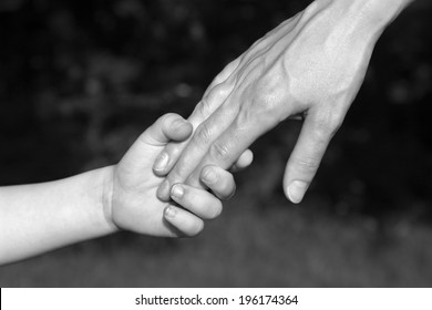 hand of mother and child