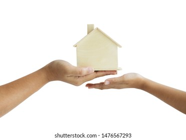 Hand of mother giving the wooden house model to daughter metaphor the legacy of real estate concept select focus shallow depth of field