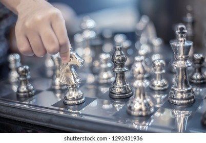 hand move silver hourse model on board strategic game to practice desision making
