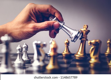 Hand moving chess on board game concept of business ideas.The battle of competition and strategy ideas with market mechanism.