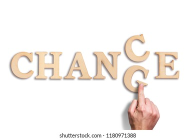 """hand moving a letter, turning the word """"change"""" to """"chance"""""""