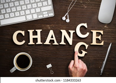 "hand moving a letter, turning the word ""change"" to ""chance"""
