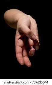 hand in mudra gesture on black background