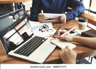 Hand multitasking man working on laptop and phone connecting wifi internet. Business People Meeting Conference Discussion Corporate Concept. Trading Online Public Relations Director Analyze Reports
